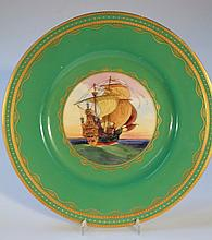A Minton cabinet plate, by James Edwin Dean, decorated with a galleon in full sail, within green and