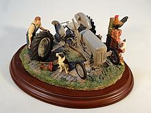 A Keith Sherwin Country Artists Country Legacy figure group, Widening The Track presented on a polis