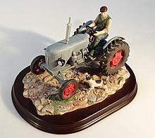 A Leonardo figure group, of a farmer on a grey Ferguson tractor, on a naturalistic base presented on