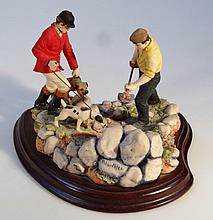 A Peter Miles figure group, of farm hands and terriers, limited edition no. 58/850, presented on a p