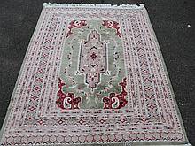 A machine woven hearth rug, of geometric pattern in red, green and black, of modern construction, 13