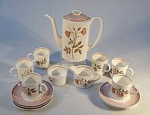A Susie Cooper Talisman part coffee service, comprising lidded coffee pot, 22cm high, six cups, six