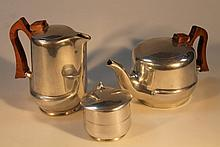 A 20thC Picquot Ware part service, comprising coffee pot, 21cm high, teapot and sugar bowl, with woo
