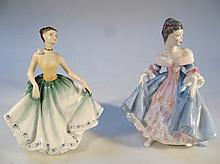A Royal Doulton figure, Southern Belle HN2425, printed marks beneath, 21cm high, and another Cynthia