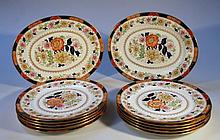 An early 20thC Cauldon part service, comprising two oval meat plates, 32cm wide, and ten dinner plat
