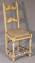 An early 20thC ladderback chair, in cream with gilt highlights, the overstuffed seat in cream floral