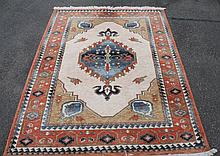 A Kabir rug, of geometric pattern in cream, blue and red, 141cm wide.