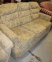 A G-Plan three seater settee, in floral material predominantly in green and fawn, of modern construc