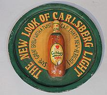A Carlsberg Light advertising plaque, of circular wooden tray form carved to the centre with a bottl