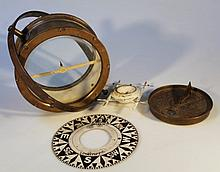 A 19thC brass compass, the 17cm dia. face fitted in a circular casing, with articulated mounts, 12cm