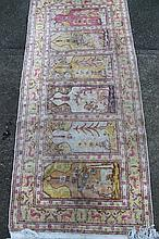 Various machine woven rugs, to include a rectangular example in geometric floral pattern in red, ora