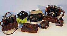 Various cameras and equipment, to include Kodak, Zeiss, Attar, a small quantity of ephemera, metal f