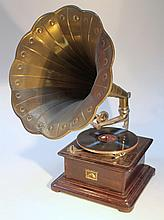 An early 20thC HMV gramophone, with brass horn of shaped floral form with chrome mounts on an invert