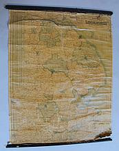 An early 20thC Bacon's Excelsior map of Lincolnshire, of folding form, surmounted by a wooden wall h