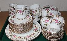 A Royal Stafford Fragrance pattern part tea service, to include serving plates, tea plates, milk jug