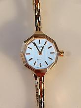 A Rotary ladies cocktail watch, the 2cm octagonal face, with baton pointers and numerals, in fitted