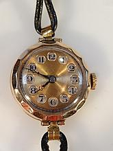 A ladies cocktail watch, the circular 3cm dial with Arabic numerals in a plain case, yellow metal ma