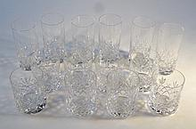A quantity of crystal glass whisky tumblers, and other glasses of cylindrical form, each with hobnai