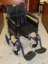 An Excel folding wheelchair, with leather seat and metal frame with rubber wheels, 92cm high.