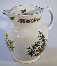 A Royal Worcester Worcester Herbs jug, of bulbous form with an upper floral banding on circular foot