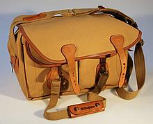 A Billingham camera bag, in khaki canvas with a fitted interior and exterior canvas straps, 30cm hig