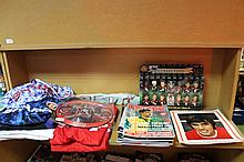 A quantity of Manchester United football shirts, ephemera, etc, to include blue and white 1990s team