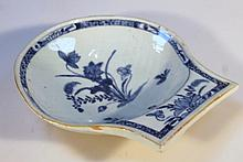 A Chinese blue and white export porcelain dish, of shell shaped form decorated with flowers with an