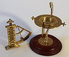 A 500th Anniversary Discovery of America ship's compass, of brass finish form on a wooden base, of m