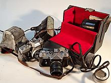 Various cameras, to include Zenit HEL IOS-44-2 lens, Minolta carrying case, 23cm high, other lens, e