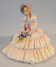 A Royal Doulton figure, Daydreams HN1731, printed marks beneath, 16cm high.