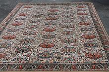An Axminster style woollen rug, of rectangular form, predominantly white background with multicolour