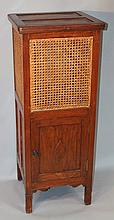 A Michael D'Soza Mufti oak cabinet, of shaped square form, the upper section with a bergere panellin