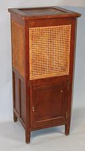 A Michael D'Soza Mufti oak cabinet, of squared form with an upper bergere panelling, with a panelled