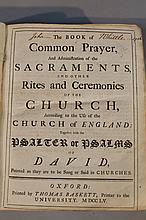 An 18thC Common Prayer book, containing sacraments and psalms, with a pressed leather binding, writt