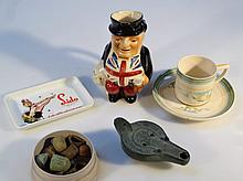 Various antiquities and artifacts, to include an oil lamp of shaped circular form, stamped Onaccam r