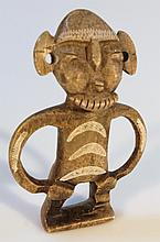 An Inca style figure, of a god of typical naive form with hands on hips, painted with white semi-cir