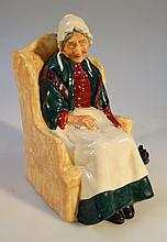 A Royal Doulton figure Forty Winks, HN1974, printed marks beneath, 16cm high.