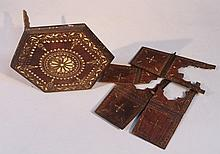 A late 19thC Indian hardwood table, of octagonal form inlaid with ivory pieces in a geometric patter