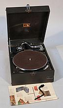 A HMV gramophone, the textured black leather case hinging to reveal a part chrome finish interior, w