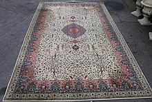 A Wilton machine woven rug, of floor standing form, geometrically decorated in blue, red and green,