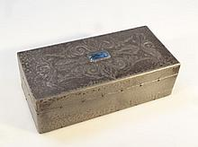 An early 20thC Arts and Crafts pewter cigarette box, the rectangular hinged lid, repoussé decorated