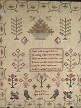 A Victorian portrait and motto sampler, by Eliza Mills, age 14yrs and dated 1844, set with the motto