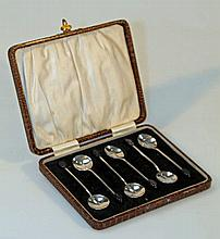 A set of six George V silver coffee bean spoons,
