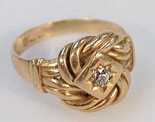 An 18ct gold knot ring, set with a central diamon