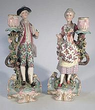 A pair of 19thC porcelain figures, of a lady and