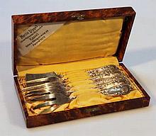A cased set of dessert cutlery, comprising forks