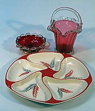 A cranberry glass basket, with a plain glass hand