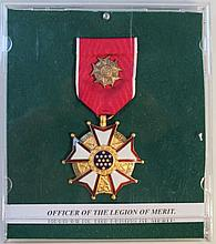 An Officer of the Legion of Merit medal, in white