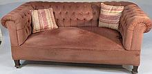 A Victorian mahogany framed drop end Chesterfield