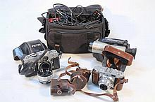 Various cameras and accessories, to include a Pet